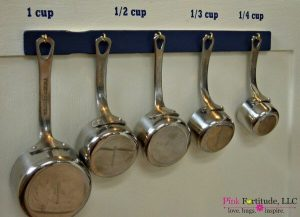Check out this awesome kitchen storage measuring cup hack.