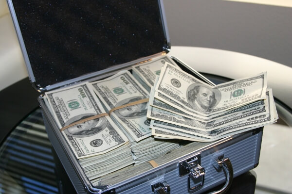Creative ways to save money, money in briefcase.