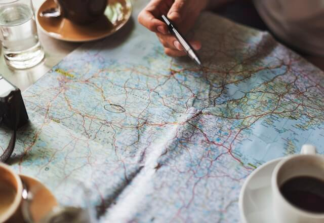 Planing out future travels on a map. Traveling is one of my favorite New Years resolution ideas.