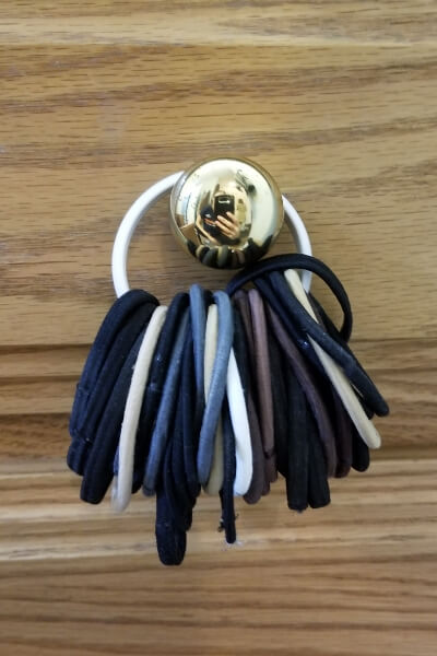 Use a shower hook for hair accessory organization.
