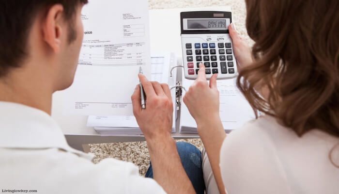 Two people budgeting money living in a high cost of living area.